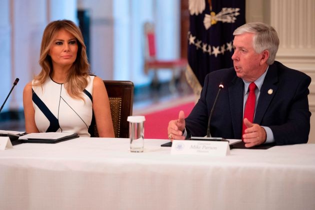 Missouri Gov. Mike Parson with First Lady Melania Trump earlier this month. Parson appears to not know...