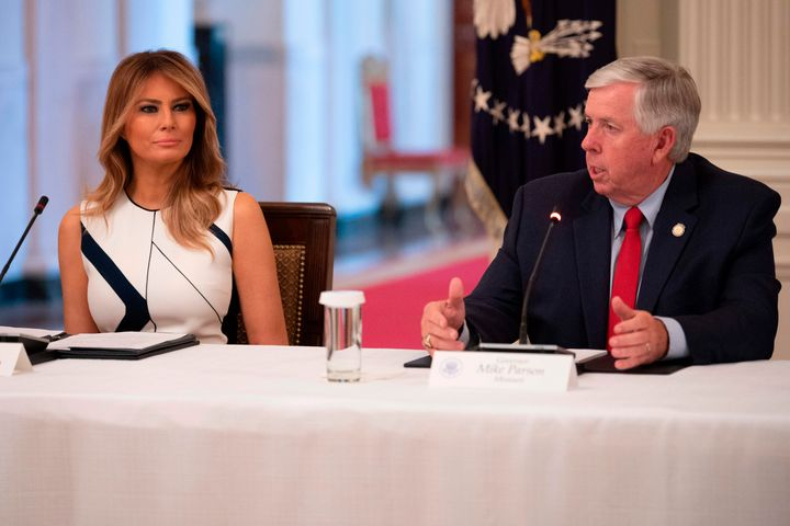 Missouri Gov. Mike Parson with First Lady Melania Trump earlier this month. Parson appears to not know or care that reopening