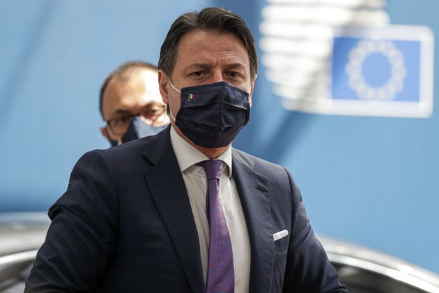 Italy's Prime Minister Giuseppe Conte, wearing a protective face mask, arrives for the fourth day of...