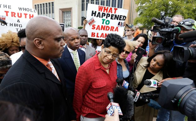Sandra Bland's mother, Geneva Reed-Veal, talks with reporters in March 2016 after an arraignment...