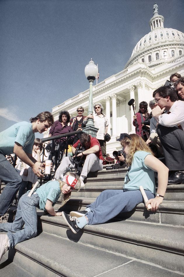 "A photo of the ""Capitol Crawl"" on March 12, 1990. While fighting for passage of the Americans..."