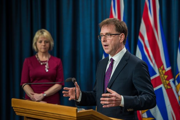 B.C. Health Minister Adrian Dix speaks during a briefing on July 16,