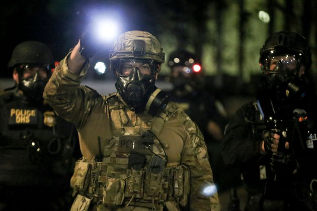 Militarized federal agents deployed by the president fired tear gas at protesters during a demonstration...