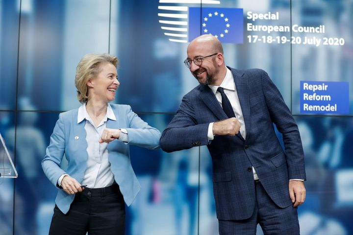 European Commission President Ursula von der Leyen and European Council President Charles Michel bump elbows at the end of th