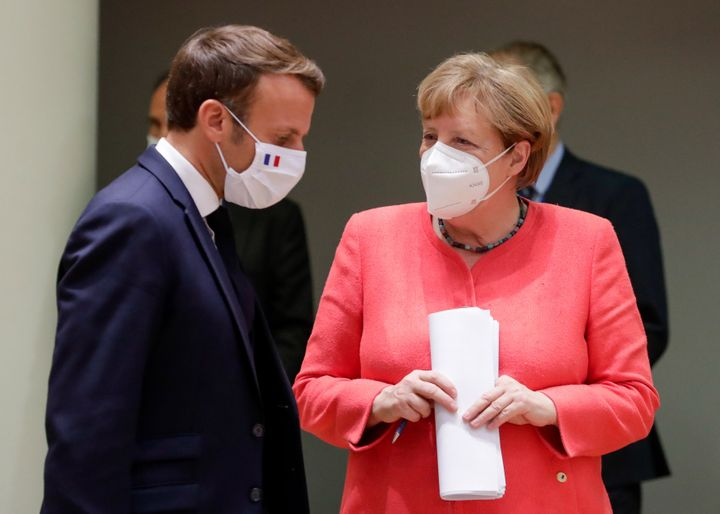 Macron and German Chancellor Angela Merkel at the summit. The two leaders pushed to approve a robust economic stimulus packag