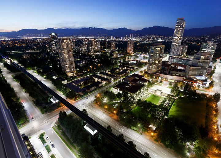 A view of Metro Vancouver is seen here at twilight on July 18, 2020, from Burnaby, B.C.Softening population growth from immigration could start to weaken house prices in the future.