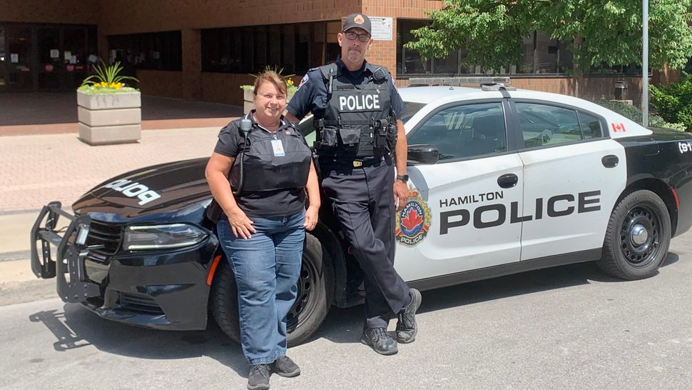 Sarah Burtenshaw, a mental health worker, and Sgt. Peter Wiesner who leads Hamilton Police's crisis teams...