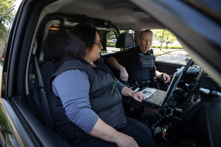 Registered psychiatric nurse Tina Baker and RCMP Cpl. Scotty Schumann are part of the mental health crisis team in Surrey, B.C., pictured here on June 25, 2020.