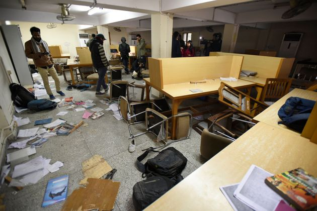 A view of the damaged Jamia Milia Islamia library after police entered the university campus Sunday evening...