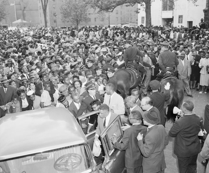 People in New York gather around Mamie Bradley, the mother of Emmett Till, to protest the acquittal of her son's murderers in