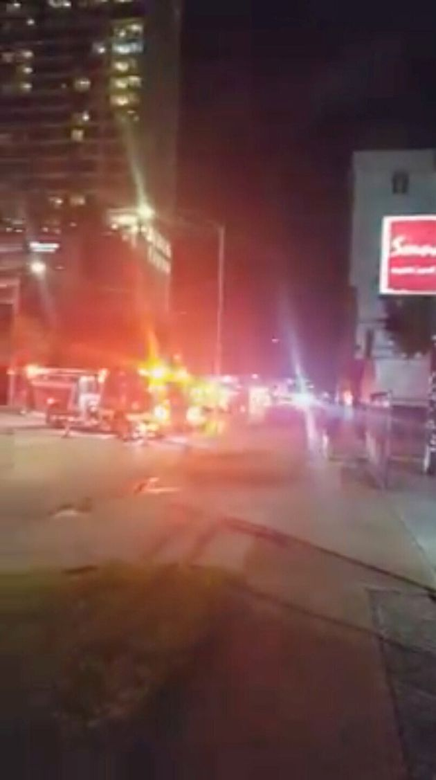 Fire trucks are seen outside the Chinese consulate, where local media reported trash cans filled with...