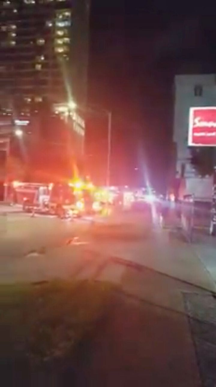 Fire trucks are seen outside the Chinese consulate, where local media reported trash cans filled with documents are being burned in the courtyard, in Houston, Texas, on July 21, 2020, in this still image taken from video obtained from social media.