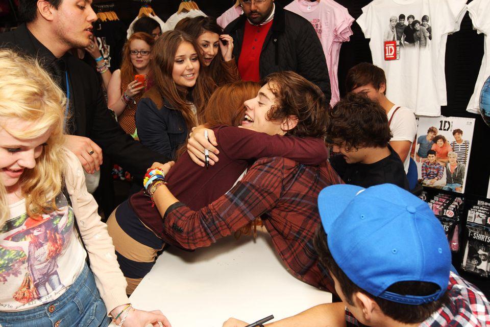 One Direction meet fans at an album