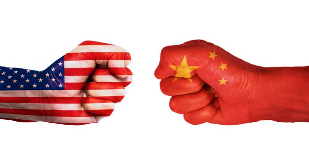 Conflict between USA and China, male fists - governments conflict