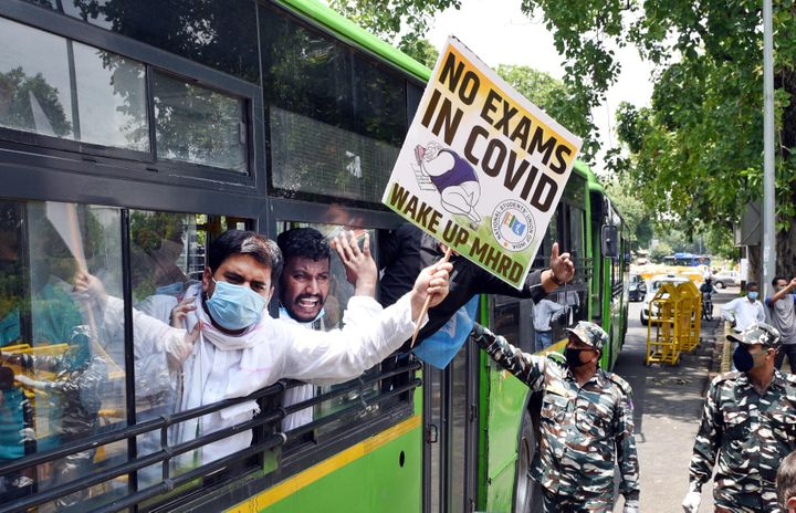 NSUI workers are detained after a protest demanding the cancellation of final year exams and promotion of students on the basis of past performance, outside HRD Ministry at Shastri Bhawan, on July 21, 2020 in New Delhi.
