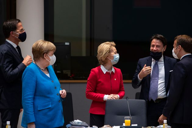 Germany's Chancellor Angela Merkel ( 2nd L) stands next to Netherlands' Prime Minister Mark Rutte (L),...