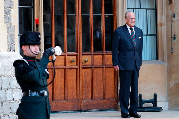 The Duke of Edinburgh listens to buglers during the transfer of the Colonel-in-Chief of The Rifles at Windsor castle in Windsor on July 22, 2020.
