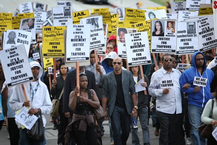 People in Los Angeles silently protest racial injustice and demand justice for Trayvon Martin.