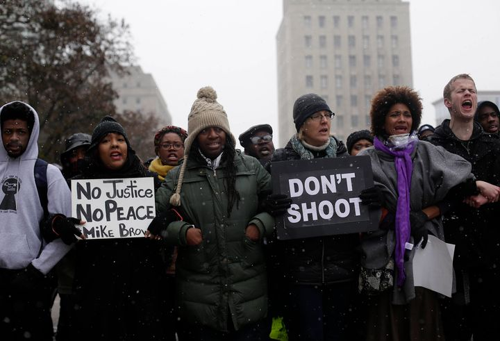 Demonstrators in November 2014 protest the killing of Michael Brown by a Ferguson, Missouri, police officer months earlier.