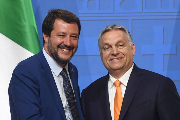 Italian Deputy Premier and Interior Minister Matteo Salvini (L) is welcomed by Hungarian Prime Minister...