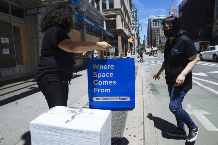 Curbside pickup at a Container Store location in New York in June. Container Store employees have to sign arbitration agreements if they want to go back to work after being furloughed.