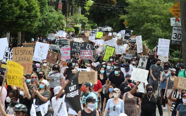 A peaceful march for Black Lives Matter in early June, following the deaths of George Floyd and Regis Korchinski-Paquet.