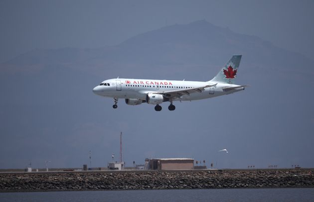 An Air Canada plane lands at San Francisco International Airport from Vancouver, on June 30,