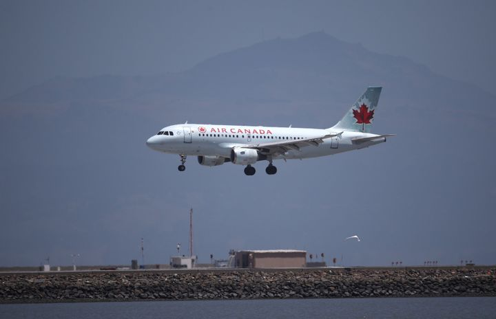 An Air Canada plane lands at San Francisco International Airport from Vancouver, on June 30, 2020.