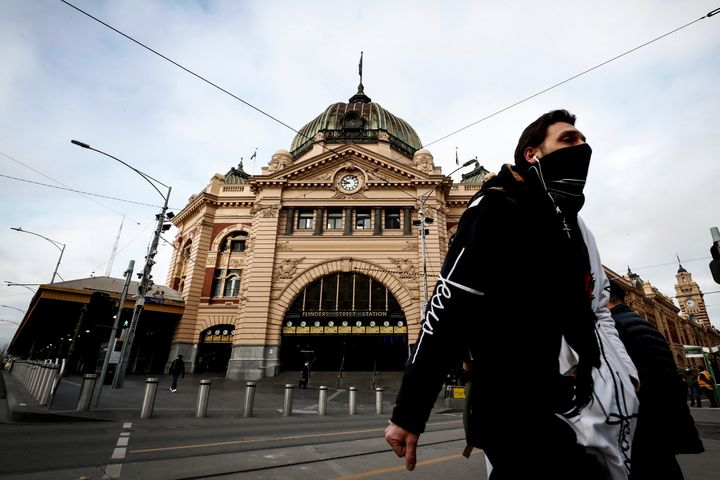 As Melbourne's metropolitan area continues to face COVID-19 restrictions, a man is seen wearing a face mask out Flinders Street Station on July 23, 2020 in the Victorian capital.