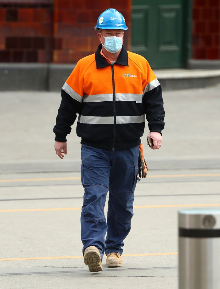 A construction worker is seen wearing a face mask on July 22, 2020 in Melbourne, Australia.Face masks or coverings are mandatory from Thursday 23 July, with $200 fines to apply for not wearing face coverings.