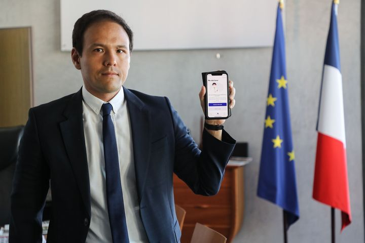 Cedric O, France's junior minister for digital affairs, presents the StopCovid contact tracing app at his office in Paris on May 29, 2020.