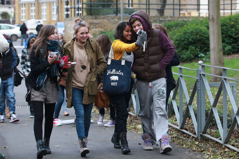 Harry Styles meeting fans out and about during the filming of The X Factor in