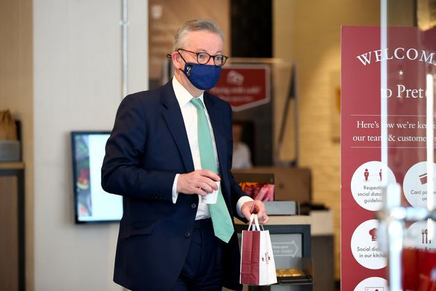 Michael Gove wears a face covering while buying food in Pret - having previously been pictured