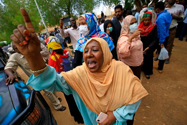 Family members of the accused rally outside the Khartoum courthouse during the trial of Sudan's ousted...