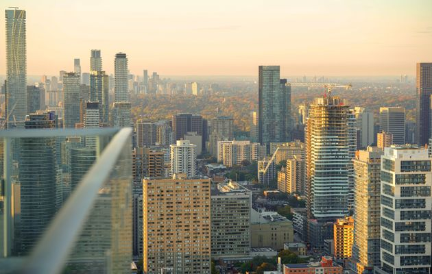 A view of high-rises in downtown and mid-town Toronto. Two new reports from Statistics Canada predict...