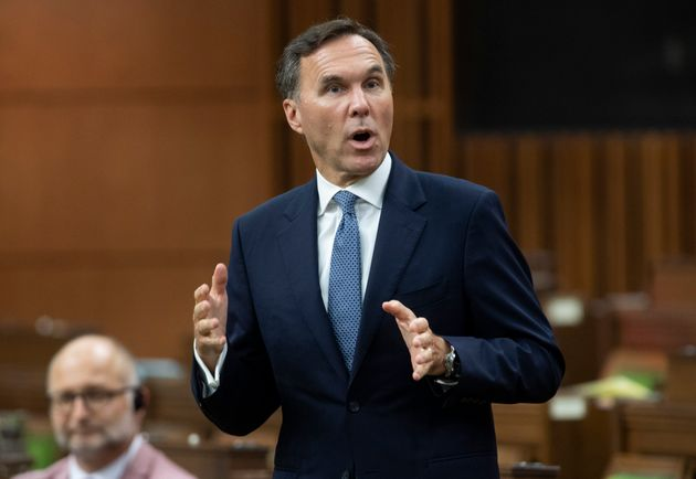 Finance Minister Bill Morneau rises during Question Period in the House of Commons in Ottawa on July...