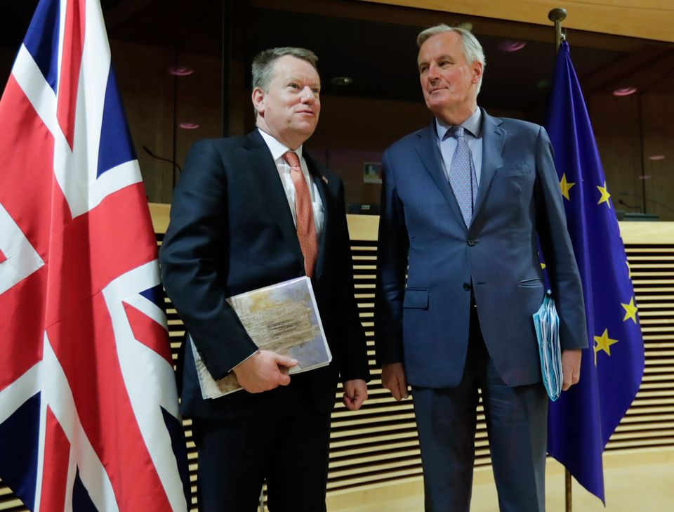European Union chief Brexit negotiator Michel Barnier, right, speaks with the British PM's Europe adviser...