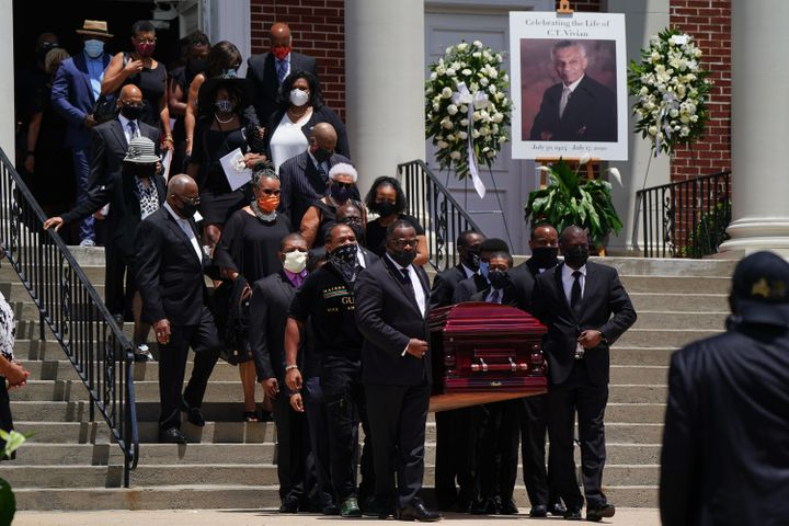 ATLANTA, GA - JULY 23: The casket holding the body of civil rights icon C.T. Vivian is carried out of Providence Missionary B