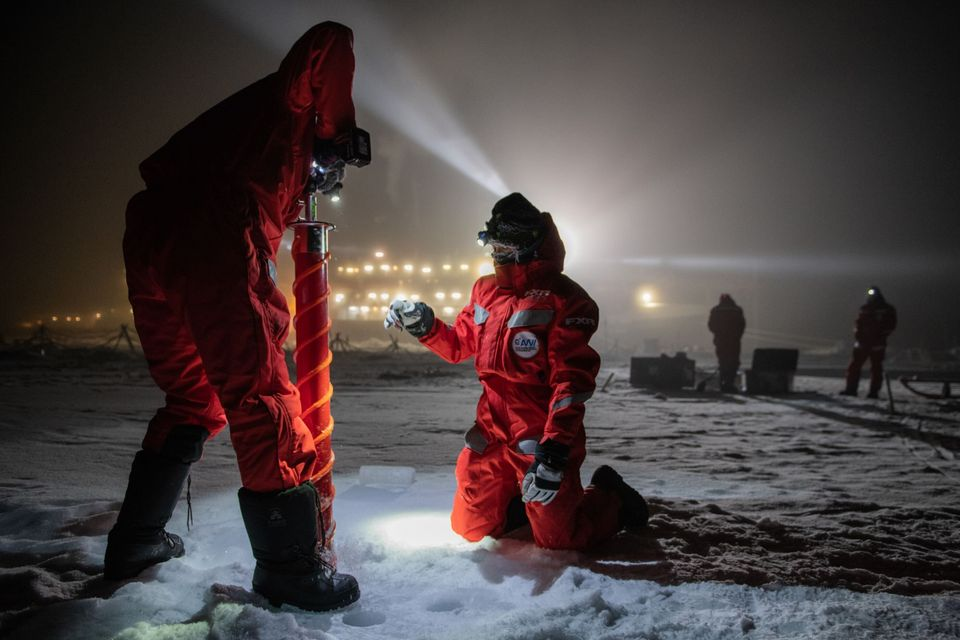Scientific teams drill into the ice to extract core samples on the afternoon of Dec. 15,