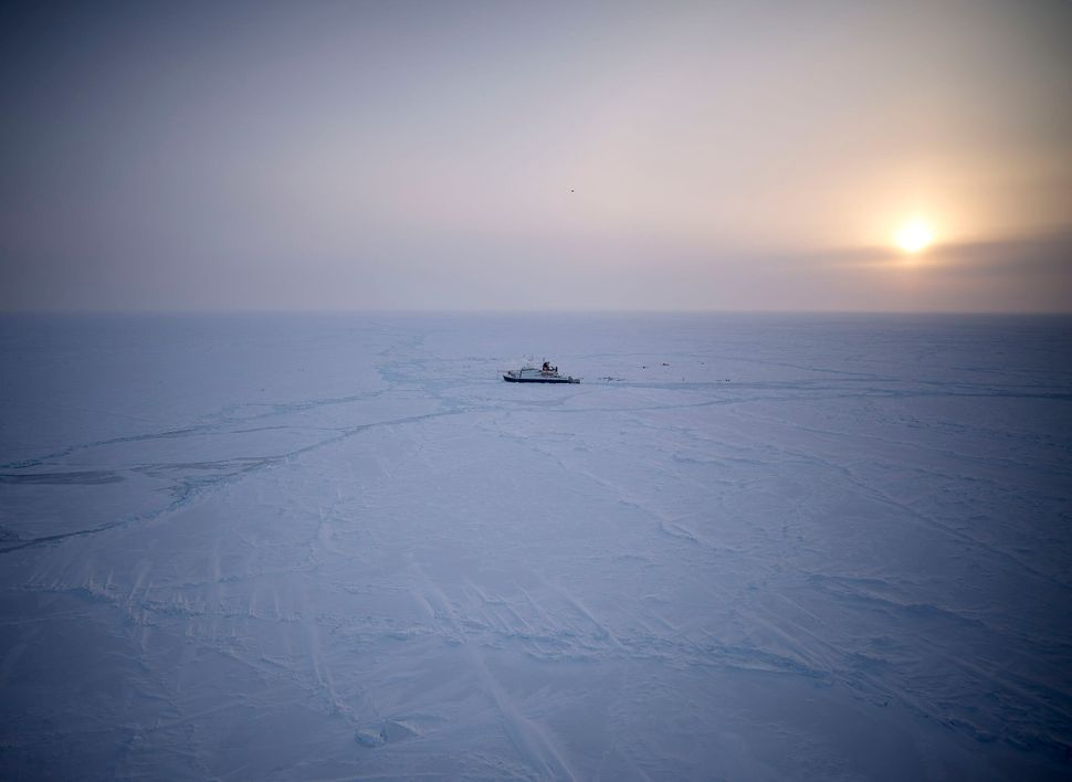 An aerial view of Polarstern, embedded in the Arctic ice.