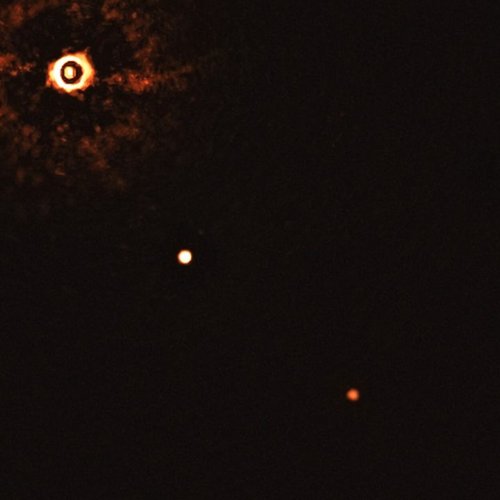 A zoomed-in view of star TYC 8998-760-1 and its two exoplanets.