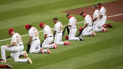 Giants And Dodgers Players Take A Knee During National