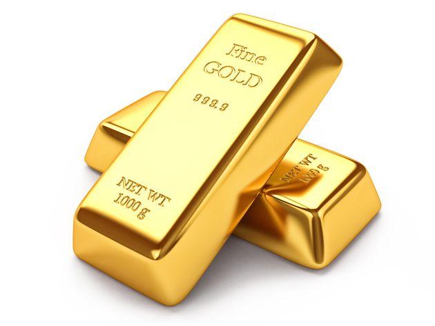 Gold ingots isolated on white