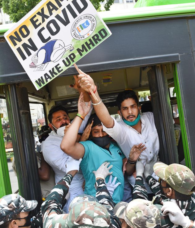 NSUI workers are detained after a protest demanding the cancellation of final year exams and promotion...