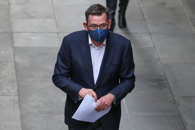 MELBOURNE, AUSTRALIA - JULY 24: Premier of Victoria Daniel Andrews wearing a mask arrives for a press...