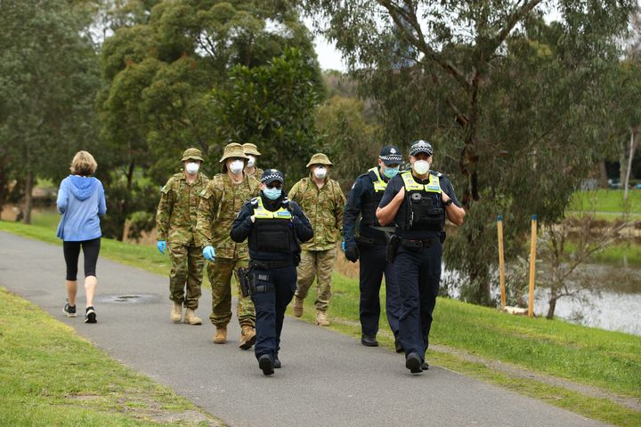 MELBOURNE, AUSTRALIA - JULY 23: Police and the Australian military patrol the banks of the Yarra River on July 23, 2020 in Melbourne, Australia.