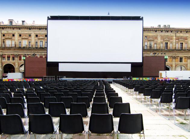 Outdoor cinema, white projection screen. Piazza Maggiore, Bologna,