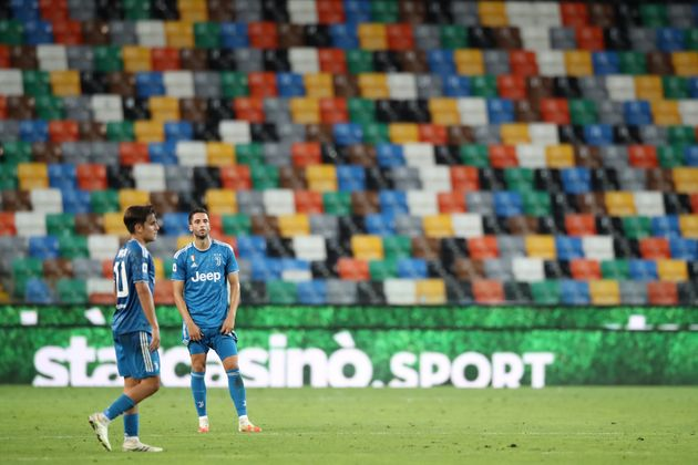 UDINE, ITALY - JULY 23: Paulo Dybala and Rodrigo Bentancur of Juventus react after Udinese Calcio took...