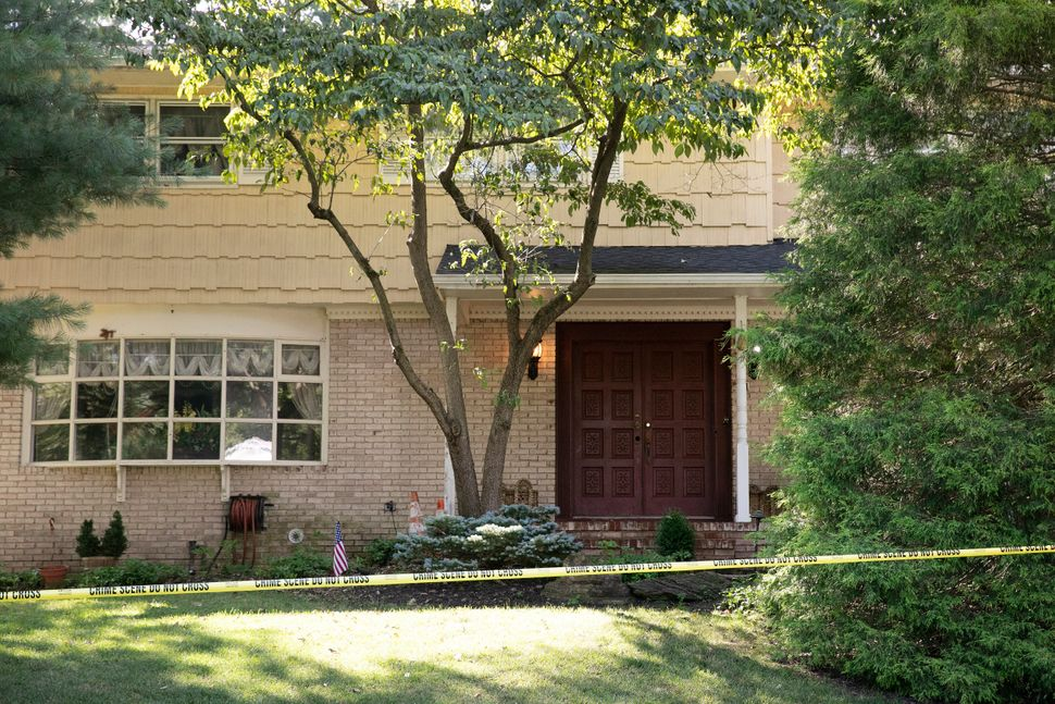 Crime scene tape surrounds the home of U.S. District Judge Esther Salas, Monday, July 20, in North Brunswick, New Jersey. A g