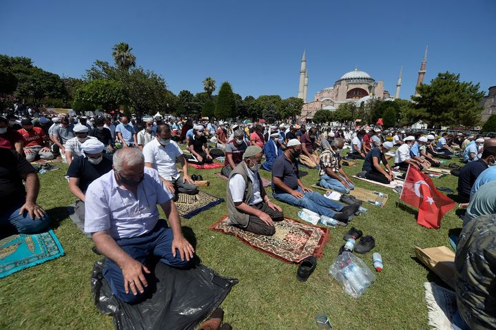 Muslims pray during Friday prayers in the historic Sultanahmet district of Istanbul, near the Byzantine-era Hagia Sophia, in